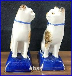 Matched Pair Antique Staffordshire Cat 7 Figurines Blue Pillow Bow White Brown