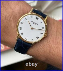 Patek Philippe 18K Yellow Gold 90s White Porcelain Roman Numeral Dial Watch